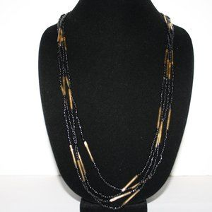 Multi strand black and gold glass bead necklace